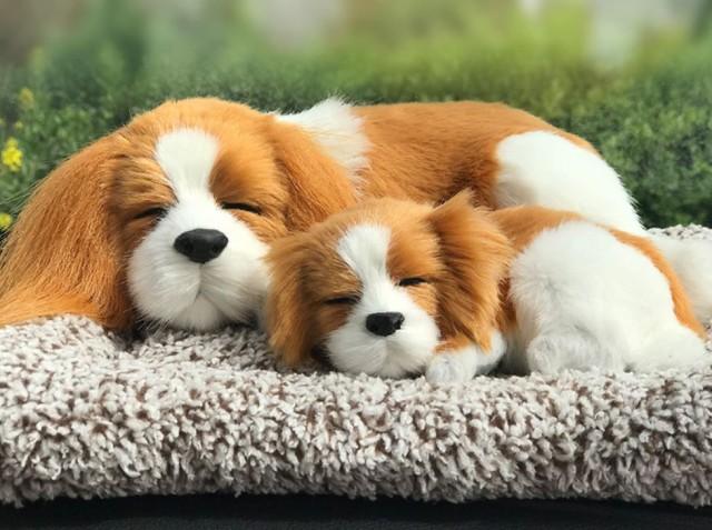【お取り寄せ】置物 マットの上で眠るリアルな犬...