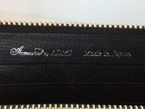 アクセソワ・ドゥ・マドモワゼル 財布 黒×シルバー×クリア 型押し加工 レザー×金属素材×ラインストーン【中古】