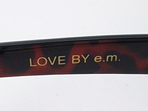 イーエム e.m. サングラス レディース 美品 クリア×ダークブラウン×黒 LOVE BY e.m. プラスチック【中古】