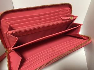 コーチ COACH 長財布 レディース - ピンク 型押し加工/ラウンドファスナー レザー【中古】