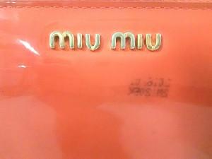 ミュウミュウ miumiu 長財布 レディース - オレンジ ラウンドファスナー/リボン エナメル(レザー)【中古】