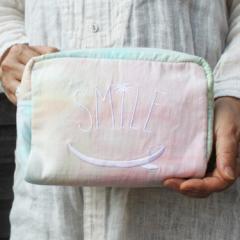 【リゾート雑貨】 翌日出荷 タッセル付 タイダイポーチ ピンク  レディースバッグ ファッション